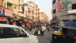 The streets in India are overcrowded and full of different types of vehicles that are all honking to get pass through.