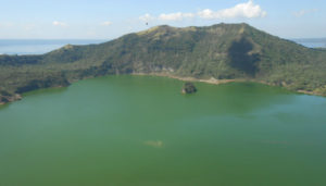 Taal Volcano, Tagaytay. There will be no swimming in this lake! When I was there I could see that the water was so hot that it was boiling.